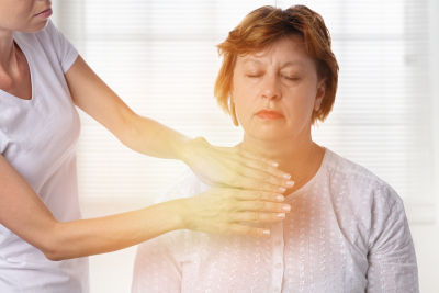 Woman having reiki healing treatment